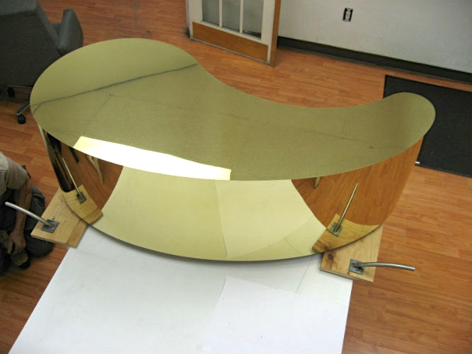 Mirror brass teardrop display